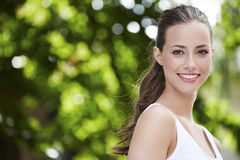 Young woman standing outdoors Stock Photos
