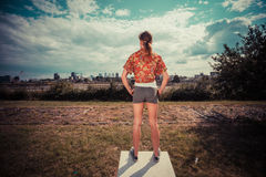 Young woman standing outside and lookign at city Stock Photos