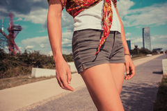Young woman standing outside on a sunny day Stock Photo
