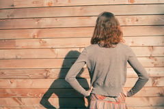 Young woman standing outside wooden cabin Stock Photo
