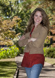 Young woman standing in park Royalty Free Stock Photography