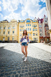 Young woman standing on paving road at old city Royalty Free Stock Photos