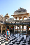 Young woman standing at Peacock Square, City Palace complex, Uda Royalty Free Stock Images