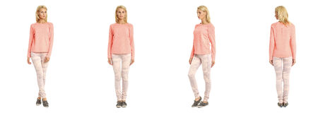Young woman standing in pink jeans on white background Stock Image