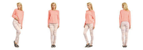 Young woman standing in pink jeans on white background Royalty Free Stock Photos