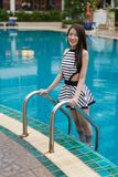 Young woman standing on pool stairs Royalty Free Stock Photography