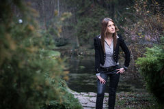 Young woman standing and posing at the forest. Young woman standing and posing Royalty Free Stock Photography