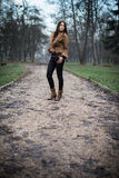 Young woman standing and posing at the forest. Young woman standing and posing Royalty Free Stock Images
