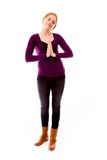 Young woman standing in prayer position Stock Photography