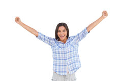 Young woman standing and raising arms Royalty Free Stock Photo