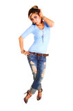 Young woman standing in ripped of jeans. Royalty Free Stock Photography