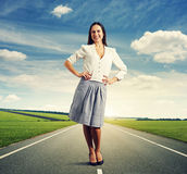 Young woman standing on the road Stock Images