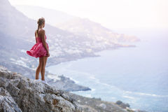 Young woman standing on rock Stock Photos