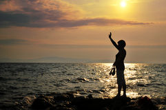 Young woman  standing on rock in sea Royalty Free Stock Images
