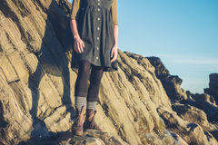 Young woman standing on rocks Stock Photo