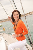Young woman standing on sailing boat Royalty Free Stock Images