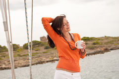 Young woman standing on sailing boat Royalty Free Stock Photos
