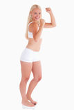 Young woman standing on a scale Stock Image