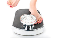 Young woman standing on a scale Royalty Free Stock Photo
