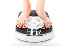 Young woman standing on a scale. Diet and weight, young woman standing on a scale, only feet to be seen stock photos