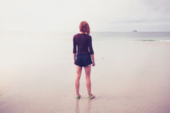 Young woman standing by the sea Royalty Free Stock Photo