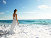 Young woman standing in sea Royalty Free Stock Image