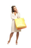 A young woman standing with shopping bags Royalty Free Stock Image