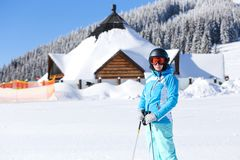 Young woman standing on the slope at ski resort Stock Photos