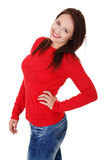 Young woman is standing and smiling. Stock Photos