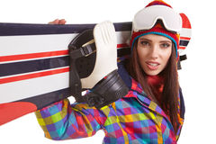 Young woman standing with snowboard isolated on white Royalty Free Stock Image