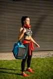Young woman with sport bag outdoor. Young woman standing with sport bag outdoor Royalty Free Stock Photography