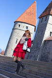 Young woman standing on stairs in old town of Tallinn Stock Images