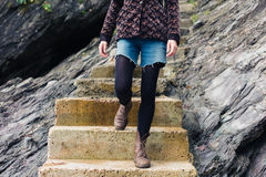 Young woman standing on steps in nature Stock Photo