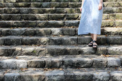 Young woman standing on the steps. Of a stone Stock Images