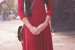 Young woman standing in the street Stock Photography