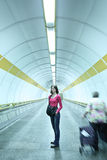 Young woman standing in a subway corridor Royalty Free Stock Images