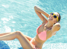 Young woman standing in a swimming pool Royalty Free Stock Photography