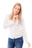 Young woman standing and thinking Stock Photo