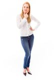 Young woman standing and thinking Stock Photography