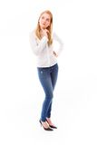 Young woman standing and thinking Stock Photos