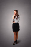 Young woman standing and thinking with copy space Royalty Free Stock Photography