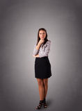 Young woman standing and thinking with copy space Stock Photography