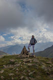 Young woman are standing on top of a mountain and enjoying. Alma Royalty Free Stock Image