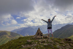 Young woman are standing on top of a mountain and enjoying. Alma Royalty Free Stock Images