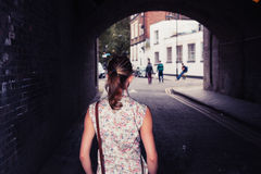 Young woman standing in tunnel Stock Image