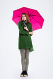Young woman standing under umbrella Stock Images