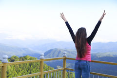 Young woman standing on viewing platform Royalty Free Stock Photo