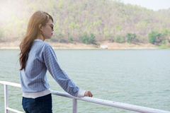 Young woman standing viewing scenery on boat. front of her have Royalty Free Stock Photo