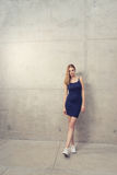Young woman standing - wall royalty free stock images