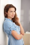Young woman standing at wall smiling Royalty Free Stock Photography